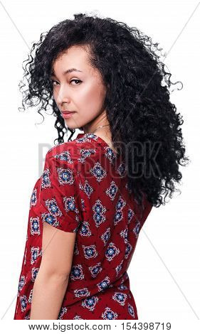 Young beautiful woman with curly black hair isolated on white background