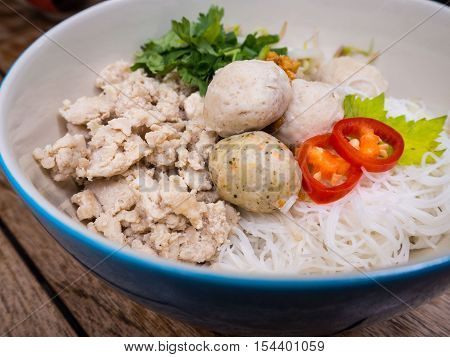 Thai minced chicken noodle with rice vermicelli and chicken balls