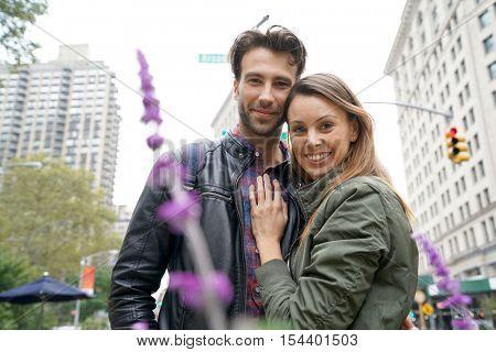 Couple standing on broadway street, New york city