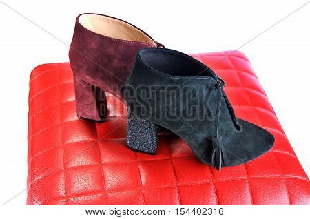 Sexy women's shoes. Red and dark green ankle boots with high heels. Women's suede shoes.
