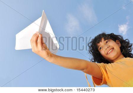 Little cute girl holding an airplane
