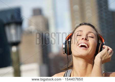 Closeup of jogger girl listening to music with headset