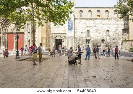 AIX EN PROVENCE,FRANCE-AUGUST 9 2016:people and tourist stroll and admire the Aix cathedral of Saint Sauveur during a sunny day.