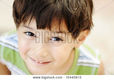 Very cute happy child, positive face, closeup