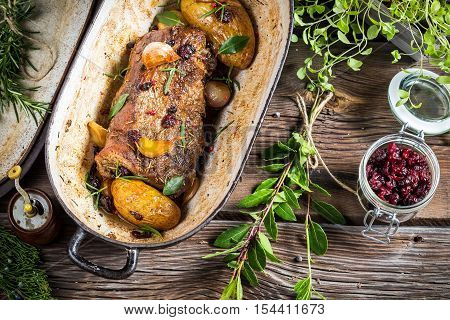 Venison Roasted With Rosemary, Garlic And Cranberries