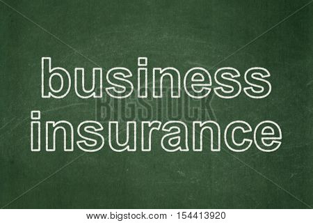 Insurance concept: text Business Insurance on Green chalkboard background