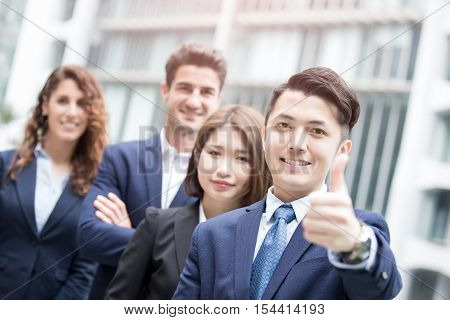 portrait of happy businessman smiles and show thumb up in hongkong