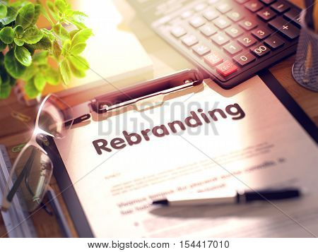 Rebranding on Clipboard. Composition on Working Table and Office Supplies Around. 3d Rendering. Blurred Illustration.