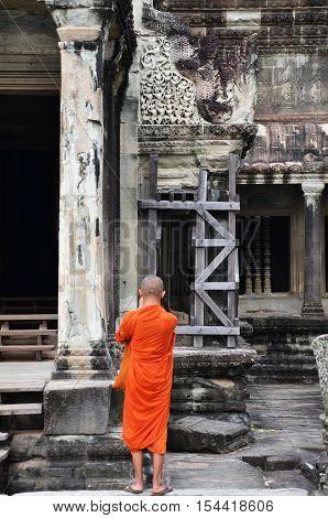 Monk Enters An Ancient Temple At Angkor Wat