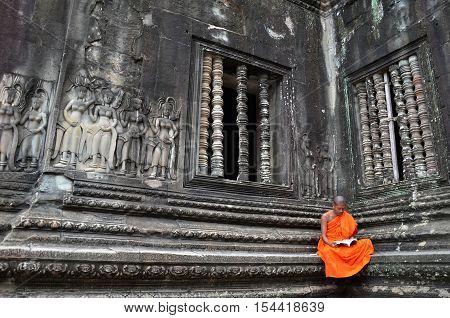 Monk Meditates At The Angkor Wat Temple