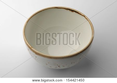 White hand-crafted chinese bowl isolated on white background