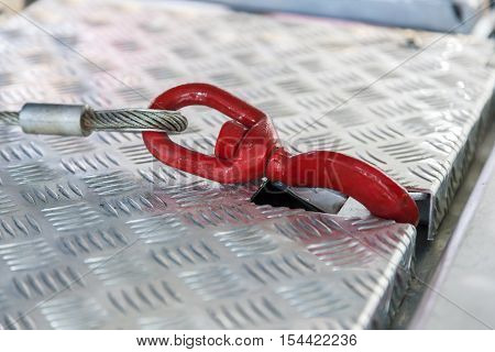 Secure truck load hook with a steel cable