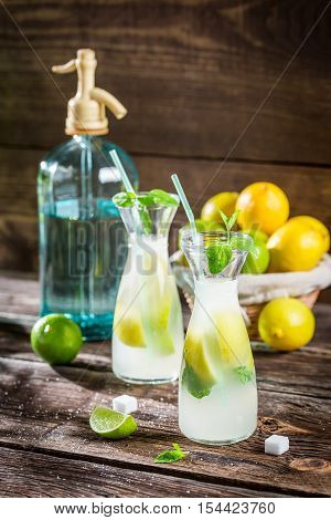Closeup of fresh lemonade with fruit on wooden table