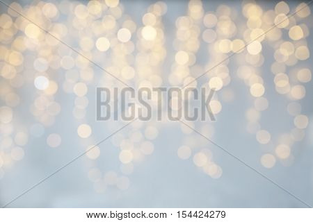background, bokeh, holidays and backdrop concept - blurred christmas lights