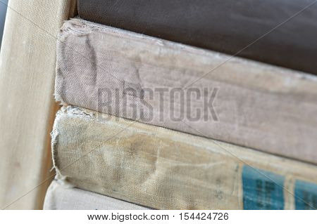A few old textbooks in a pile close up