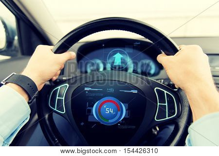 transport, business trip, technology and people concept - close up of male hands holding car wheel and driving with volume level icon on board computer screen