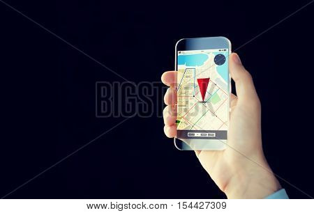 people, modern technology, application and navigation concept - close up of male hand holding and showing transparent smartphone with gps and road map on screen over black background