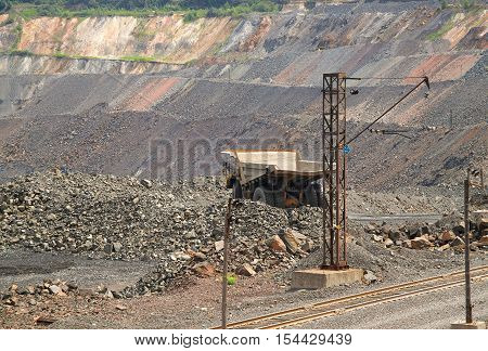 View to the iron ore opencast with dump truck road and railway track for transporting ore from the quarry