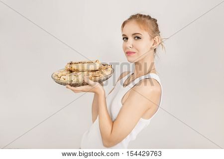 happy woman show dish with doner kebab on white background with copyspace, toned image