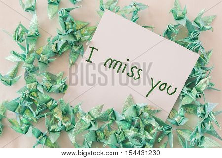i miss you feeling message card and folded paper bird