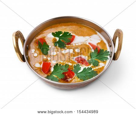 Vegan and vegetarian dish, spicy lentil dahl soup bowl. Indian cuisine, masala hot dal meal isolated on white background. Eastern local cuisine restaurant food.