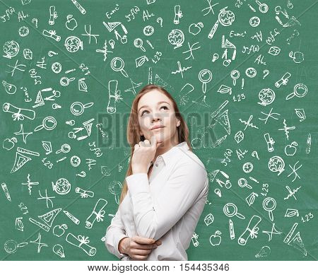 Woman Near Green Blackboard With Education Icons