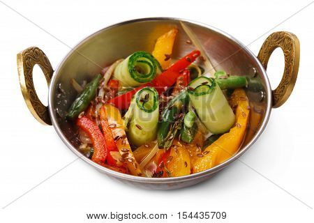 Vegan and vegetarian dish, spicy vegetable salad in bowl. Indian cuisine, cucumber, sesame and pepper mix with herbs, healthy meal isolated on white background. Eastern local cuisine restaurant food.