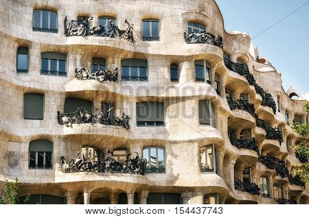 Barcelona, Catalunia, Spain - May 30, 2015: Exterior of the Casa Mila La Pedrera by Antonio Gaudi. Part of the facade. UNESCO World Heritage Site Works of Antonio Gaudi . Barcelona Spain.