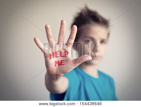 Little boy asking for help. Violence concept.