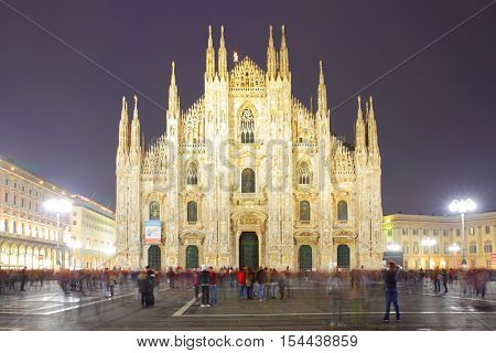 Milan Cathedral (Duomo di Milano) at night, Italy (People in motion blur)
