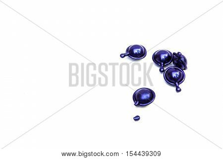 Hair vitamin serum capsule blue color on white background. poster