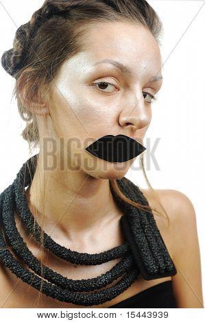 Shiny doll girl with fake lips, conceptual photo