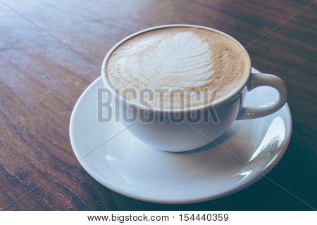 Cup Of Hot Coffee Put On Old Wooden Table Background