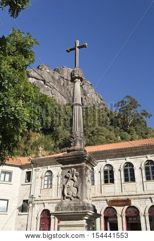 PENEDA, PORTUGAL - October 9, 2016: Detail of the column with a cross on top at the plaza of the Church of Our Lady in the Peneda Geres National Park North of Portugal