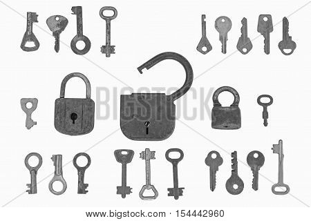 The locks and keys.One big open lock and two smaller lock are among many different keys on the white background.