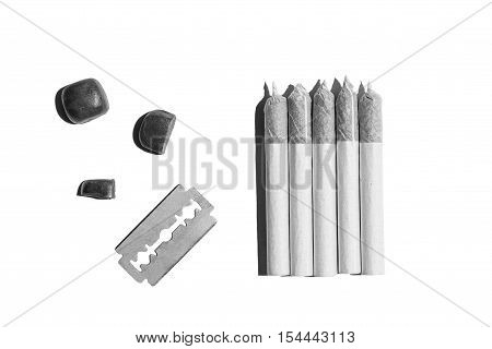 Rolled cigarettes of hemp.Five rolled cigarettes of cannabis blade and stones are isolated on the white background.