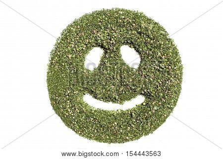Smiley emoticon.Happy smiley emoticon made of green grass of cannabis.