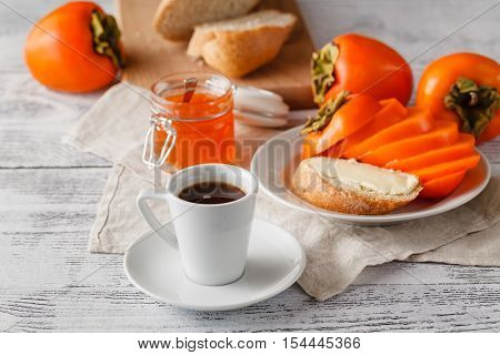 Breakfast With Persimmon Fruit Jam And Coffee On Wooden Table
