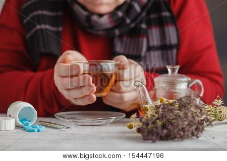 Hot Tea Against Fever. Male Looks The Temperature On The Thermometer And Drinking Herbal Tea With Ho