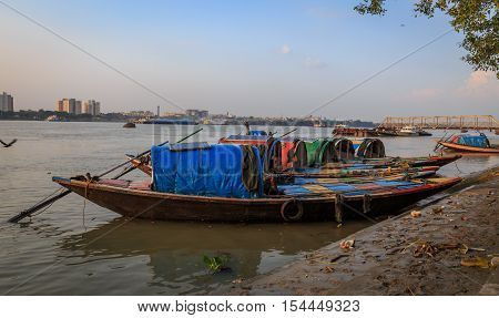 Wooden country boats lined up at the Ganges river bank at Princep ghat, Kolkata. These boats are used for pleasure boat rides on the Ganges.
