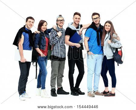 group of smiling friends staying together and looking at camera isolated on white background