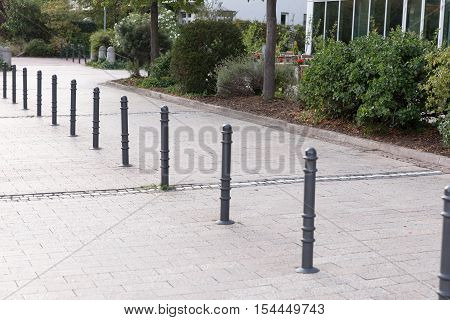 Bollards made of metal on a promenade in a row