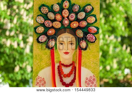 Kyiv Ukraine Sophia Square - 2 of May 2016. Easter composition. Ukrainian Easter portrait of a woman in traditional suit and circlet of painted eggs on her head.