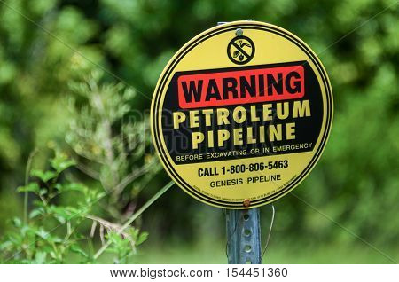 Atmore, USA - July 7, 2015: Warning sign for Genesis petroleum pipeline