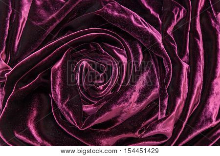 Vinous silk velvet. Vinous silk velvet fabric twisted in form of the rose.