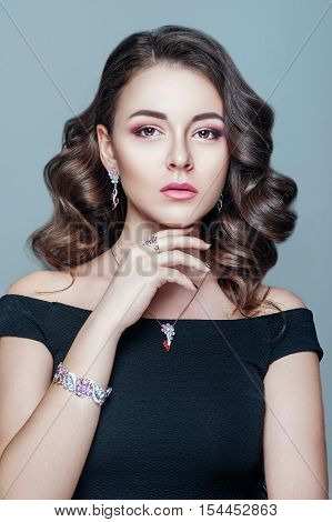 Elegant fashionable woman with jewelry. Beautiful woman with expensive pendant. Jewellery and accessories. Fashion and beauty salon. Perfect makeup.