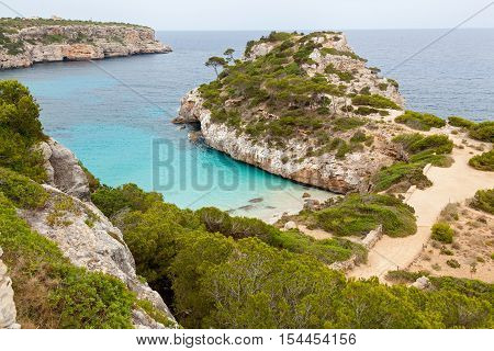 Cala S'Almon a. Cala S'Almon a - one of the many bays of Mallorca the town Santany . Located in the south-east of the island. Bay surrounded by mountains covered with pines