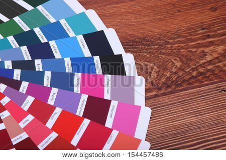 collection of ral colours on wooden background. colored paper