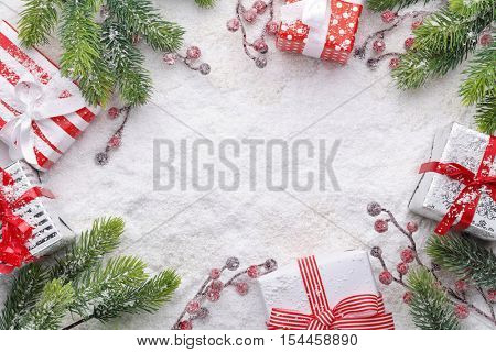 Christmas gift box and fir branch on snow