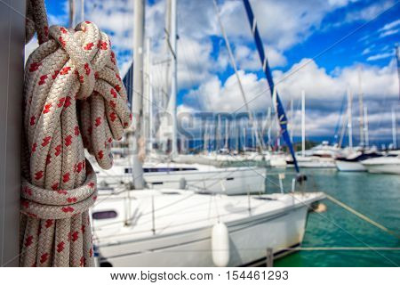 Thick ship vessel rigging rope on a boat, marina in background